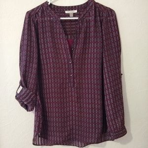 Maroon print blouse with roll-tab sleeves
